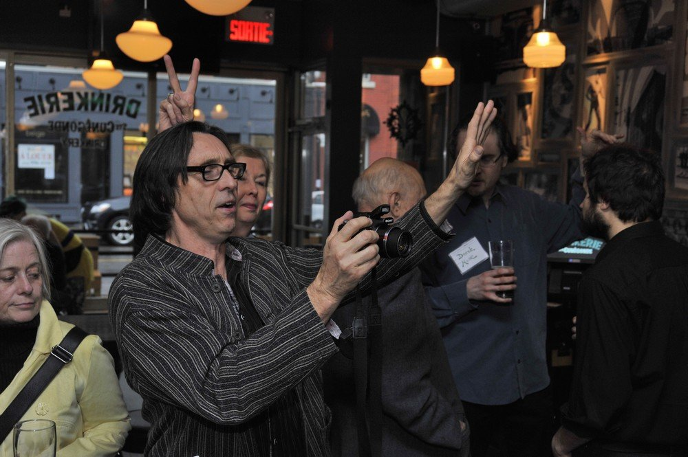 1. Guy Rodgers photographing guests at ELAN-QWF schmoozer (La Drinkerie)